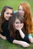 不同的女孩放牧坐三 免版税库存图片