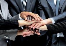不同的小组工作者用一起他们的手 免版税库存照片