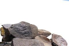 不同的形状灰色,粗砺和接合的石头在白色背景的在近距离 图库摄影