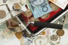 不同的收藏家` s硬币和钞票 免版税库存照片