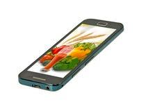不同的菜的图象在一个手机特写镜头的 库存图片