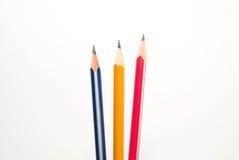 不同的颜色三支铅笔在白色 免版税图库摄影