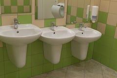 不同的高度三个水槽在公共厕所的 免版税图库摄影