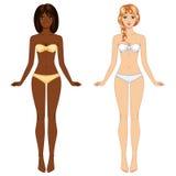 从不同种族的两个年轻人赤足女孩 免版税库存照片
