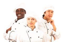 不同种族的小组厨师 库存照片