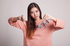 不快乐的亚洲女孩展示翻阅下来用两只手 库存图片