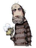 不快乐的人饮用的啤酒 库存照片