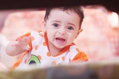 不快乐的女婴 免版税图库摄影