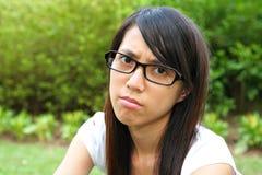 不快乐的妇女 免版税图库摄影