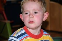 不快乐的男孩 免版税库存图片
