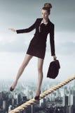 不稳定的平衡的女商人 库存图片