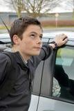 不耐烦地等乘驾的男孩 免版税图库摄影