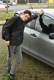 不耐烦地等乘驾的男孩 图库摄影