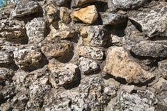 不规则形状图形设计墙纸的背景纹理石头墙壁的看法  库存照片