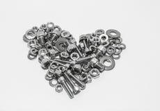 不锈的螺丝,心脏形状 库存照片