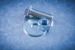不锈的screwbolt螺栓洗衣机和螺丝坚果在金属surfac 库存图片