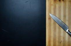 不锈钢厨刀裁减板器物 库存照片