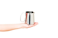 不锈钢牛奶在白色在手中隔绝的锅炉水罐 免版税库存图片