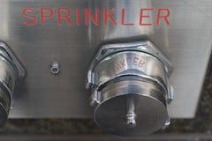 不锈钢自动洒水装置盖子和板材 库存照片