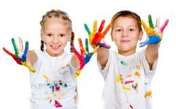 与ââhands的孩子在油漆 免版税库存照片