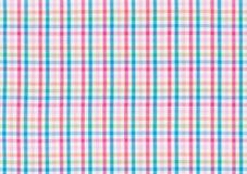 与一个五颜六色的被检查的样式的纺织品 免版税库存照片