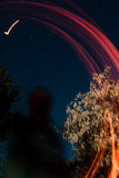 与一个大熊座星座的抽象图画发火焰足迹夜表现在背景 免版税库存图片