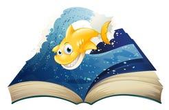 与一个微笑的鲨鱼的一本开放故事书 免版税库存照片