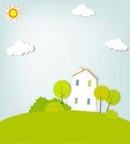 与一个房子的风景小山的 免版税库存图片