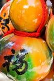 与一个手写的汉字意思'好运的'被洗染的和被绘的金瓜工艺 库存照片