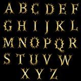 与一个易爆的作用的时髦的英语字母表 免版税库存照片