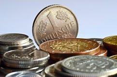 与一个杰曼标记的硬币 免版税库存照片