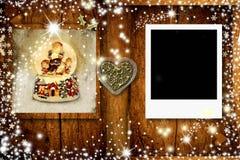 与一个框架的圣诞节明信片的照片 免版税库存照片