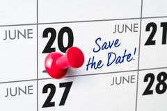 与一个红色别针的挂历- 6月20日 图库摄影