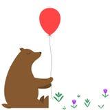 与一个红色气球的动画片熊 库存照片