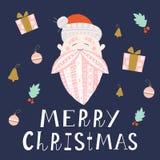 与一个被仿造的胡子的逗人喜爱的圣诞老人 库存照片