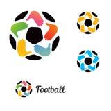 与一个足球的商标用他的手 免版税图库摄影