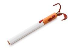 与一个钓鱼钩的香烟 免版税库存照片