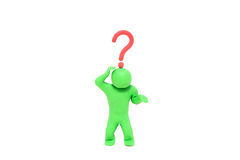 与一个问号的小彩色塑泥木偶在头 库存照片