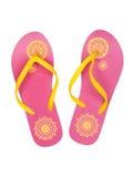 与一个黄色模式的桃红色夏天海滩鞋子 库存照片