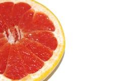 与一半的在白色背景的葡萄柚和片断 库存照片