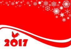 2017年 与一只雄鸡的圣诞卡在红色背景 免版税图库摄影