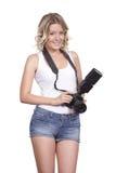 与一台照相机的快乐的妇女射击反对白色背景 库存图片