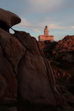 与一座灯塔的日落在意大利 图库摄影