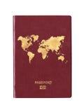 与一张世界地图的护照在盖子 免版税库存照片