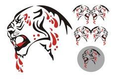 与一张开放嘴和血液下落的部族大猫 免版税库存图片