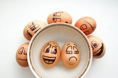 与一张快乐的被绘的面孔的鸡蛋 照片 免版税图库摄影