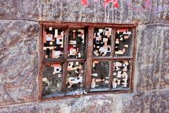 与一张拼贴画的老窗口在玻璃 免版税库存图片