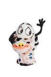 与一张滑稽的面孔的白鸡蛋在立场 免版税库存照片