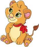 与一把红色弓的动画片幼狮坐 免版税图库摄影
