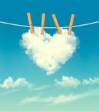 与一朵心形的云彩的华伦泰背景 免版税库存图片